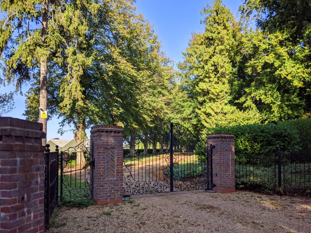 gravel path with gate leading to Pitt Manor