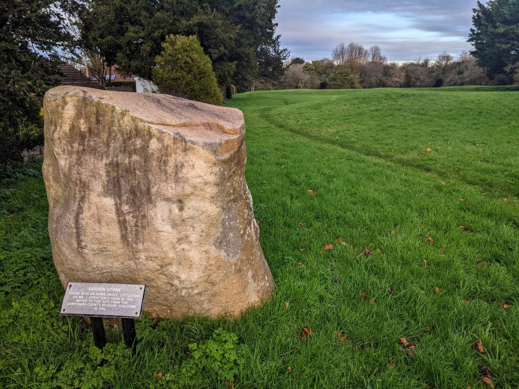 Sarson Stone in front of burial mound