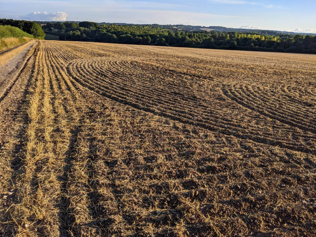 plowed field and view towards Winchester
