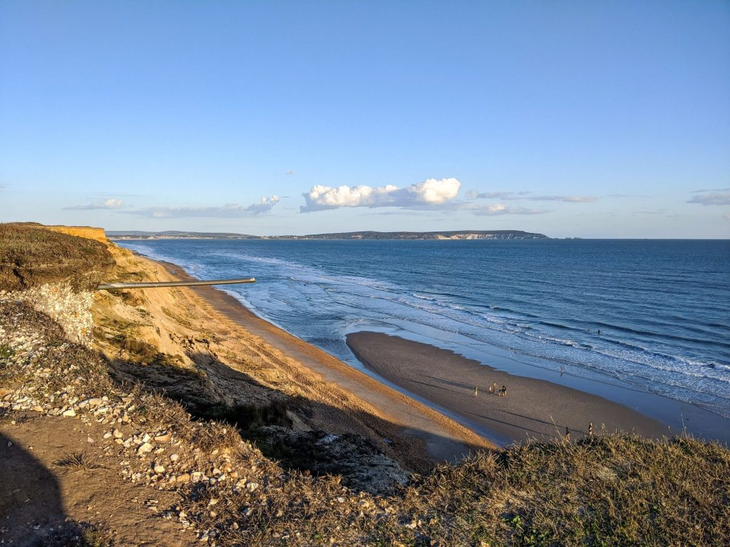 Sandy beach at low tide and view to Isle of Wight