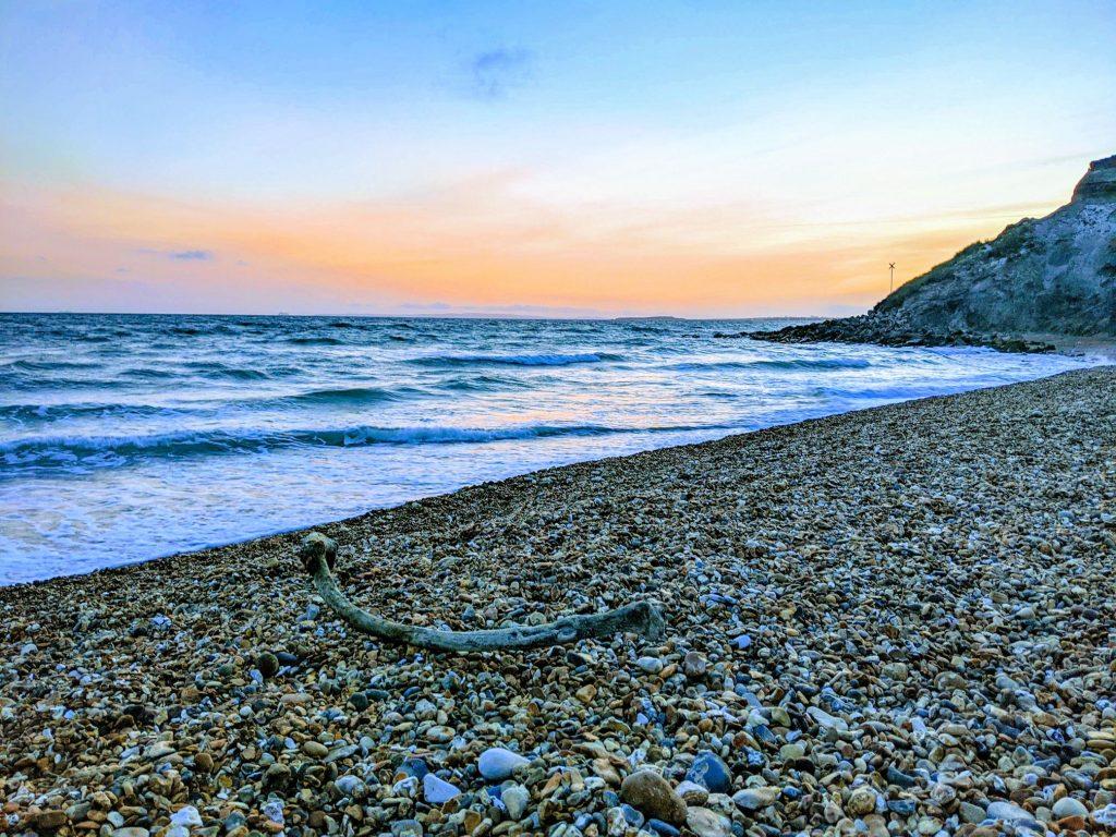 Pebble beach at sunset