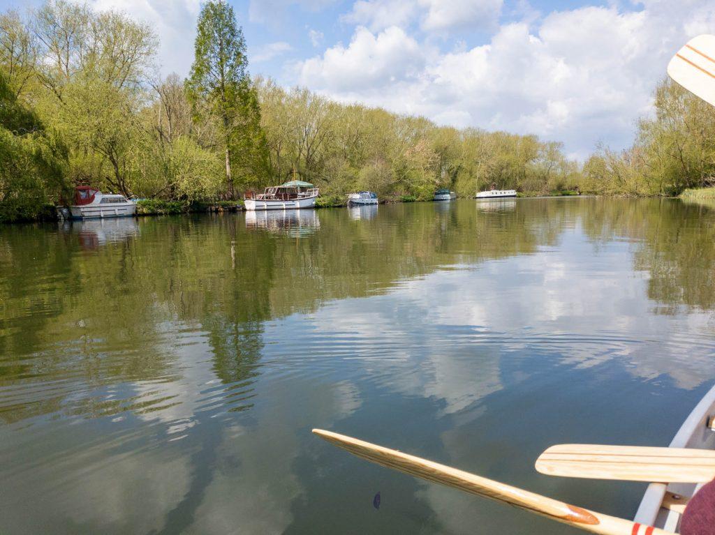 Boats moored along the River Thames